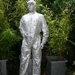 Mannequin man performing as a silver human statue at a birthday party in Muswell Hill
